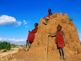 Three Young Maasai Goat Herds on a Termite Mound  Longido  Arusha  Tanzania