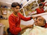 Young Man Shaving Older Man in Indian Barber Shop  Dar Es Salaam  Tanzania