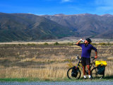 Cyclist Having a Drink on the Side of the Highway between Twizel and Omarama  Otago  New Zealand