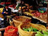 Trader at Market Stall in Old Town  Lijiang  Yunnan  China