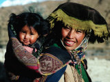 Mother Carrying Daughter Swathed in Hand Woven Fabrics  Peru