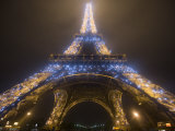 Looking Up at Eiffel Tower in Fog and Rain at Night  Paris  France