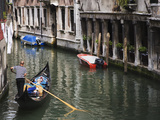 Gondola with Passengers on a Canal  Venice  Italy