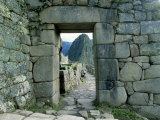 View Through Stone Doorway of the Inca Ruins of Machu Picchu in the Andes Mountains  Peru