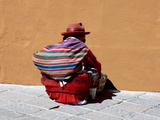 Old Woman with Sling Crouches on Sidewalk  Cusco  Peru