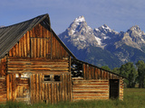 Weathered Wooden Barn Along Mormon Row with the Grand Tetons in Distance  Grand Teton National Park