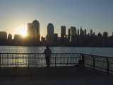 Fisherman Fishing from a Jersey City Pier at Dawn Facing the Manhattan Skyline  Jersey City