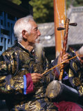 Portrait of an Elderly Musician from the Naxi Orchestra Practising by the Black Dragon Pool  China