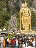 Statue of Hindu Deity with Pilgrims Walking 272 Steps up to Batu Caves  Selangor  Malaysia