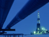 Alaska Oil Pipeline and Oil Rig at Night