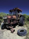 Abandoned Tractor Rusts Away Behind a Coastal Sand Dune  Australia