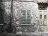 Bicycle Leaning against a Stone House in Ravenna  Italy