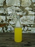 Bottle of Limoncello Sits on a Picnic Table at a Tuscan Villa  Tuscany  Italy