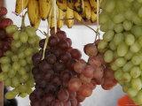 Grapes and Bananas Hanging at an Outdoor Market  San Cristobal de Las Casas  Mexico