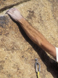 Detail of a Rock Climbing Bolt and a Climber's Forearm  California