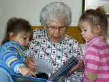 Great Grandmother Reads to Her Great Grandchildren