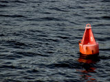Red Buoy Marked with Number Eight Floating on Calm Seas
