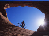 Mountain Biker Stands under an Arch