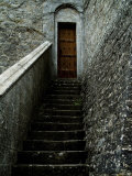 Narrow Stairway to a Wooden Door Inside the Grounds at Brolio Castle  Tuscany  Italy