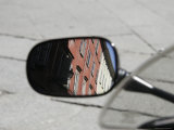Reflection of Exterior Buildings from a Rear View Motorcycle Mirror  Parma  Italy
