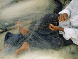 Photo of a Fisherman Repairing his Net  Egypt