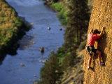 Man Climbing a Rock Wall above the River  Oregon