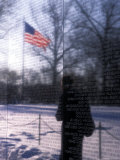 The American Flag Reflects into the Vietnam Memorial  Washington  DC
