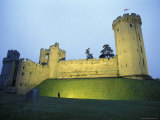 Warwick Castle at Dawn with a Man Walking in Warwickshire  England