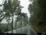 View Through the Window of a Car Driving Through the Rain in Tuscany  Italy