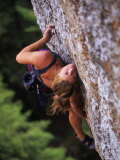 Women Makes a Move on a Rock Climb in Wyoming