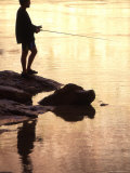 Silhouette of Man Fishing from the Edge of the River  Colorado