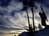 Silhouette of a Skier Standing on Hill with Skis on his Back  Colorado