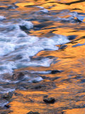 Scenic of Moving Water Reflecting Sunlit Canyon Walls  Colorado