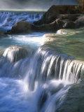 Water Flowes over Travertine Formations Below Havasu Falls