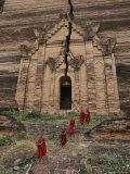 Young Buddhist Monks near a Ruined Temple in Laos