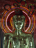 Waist-Up Shot of a Uniquely Designed  Green Metallic Buddha