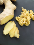 Fresh Ginger Root in Slices and Grated