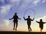 Silhouette of Children Jumping Rope Outdoors Papier Photo par Mitch Diamond