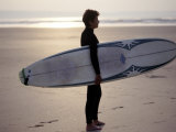 Surfer on a Beach  North Devon  England