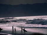 Surfers at Sunset  Ehukai  Oahu  Hawaii
