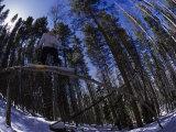 Man Riding Log on Snowboard  Vail  CO