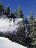 Airborne Man on Snowboard