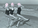 Three Women on Beach with Pink Towels on Head