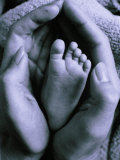 Mother's Hand Holding Baby's Foot