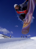 Snowboarder with Colorful Board Doing a Trick