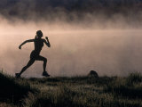Silhouette of Woman Trail Running  CO
