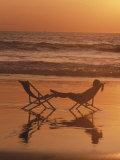 Silhouette of Woman in Beach Chair on the Beach