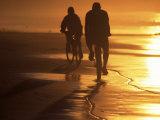 Couple Biking Toward Sunset  Monterey  CA