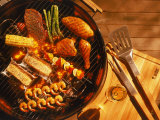 Vegetables  Fish  Poultry  and Red Meat on a Grill