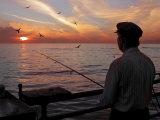 Man Fishing During Sunset  Santa Monica  CA